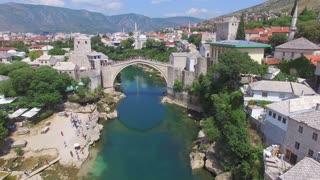 Crowd watching people jumping of the bridge in Mostar