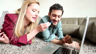 Cute couple doing online shopping in living room