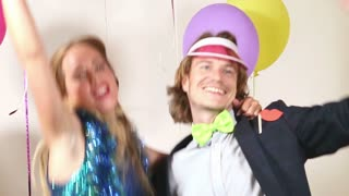 Cute happy couple dancing in photo booth