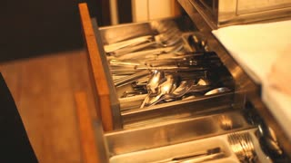 Cutlery put in kitchen drawer