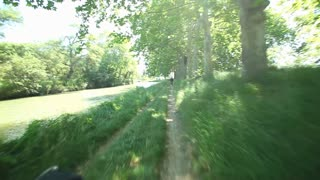Cycling on track next to Canal du Midi in France