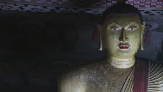 DAMBULLA, SRI LANKA - FEBRUARY 2014: Close up view of sitting Buddha at the Golden Temple of Dambulla. The Golden Temple of Dambulla is a World Heritage Site in Sri Lanka.