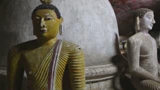 DAMBULLA, SRI LANKA - FEBRUARY 2014: Close up view of sitting Buddhas at the Golden Temple of Dambulla. The Golden Temple of Dambulla is a World Heritage Site in Sri Lanka.