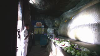 DAMBULLA, SRI LANKA - FEBRUARY 2014: Pan shot of sleeping Buddha at the Golden Temple of Dambulla, a World Heritage Site in Sri Lanka.