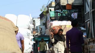 DELHI, INDIA - 4 MARCH 2015: Men transporting load at street in Delhi.