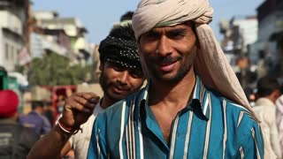 DELHI, INDIA - 4 MARCH 2015: Portrait of two handsome Indian men at street in Delhi.