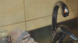 Dripping tap in kitchen