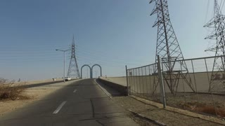 Driving through archway on Aswan bridge, Egypt