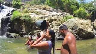 ELLA, SRI LANKA - MARCH 2014: Local people bathing at Ravana waterfalls