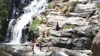 ELLA, SRI LANKA - MARCH 2014: People enjoying the Ravana Falls in Ella. It currently ranks as one of the widest falls in the country.