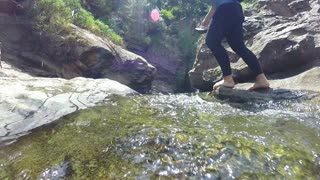 ELLA, SRI LANKA - MARCH 2014: Slow motion of woman passing the river.