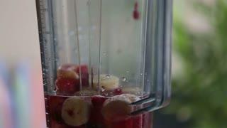 Extreme close-up of blending fruits in blender