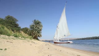 Felucca, traditional wooden sailing boat on shore of Nile.