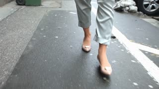 Female shoes walking down the street