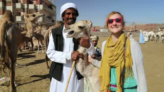 Female tourist with local man at Camel market