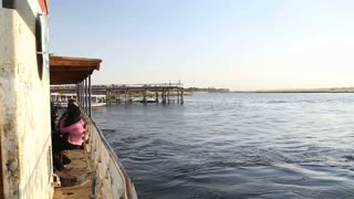 Ferry boat leaving port and sailing on Nile river