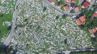 Flying over Bosnian graveyard