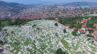 Flying over Bosnian town with Muslim cemeteries