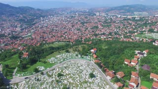 Flying over Bosnian town with Muslim graveyards
