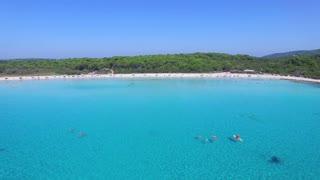 Flying over clear blue mediterranean bay
