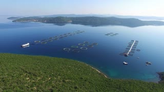 Flying over fish farm in Dalmatian sea