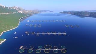 Flying over fish farm in deep blue Dalmatian sea