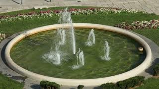 Fountain spray in circular pond