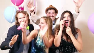 Friends enjoying in party photo booth