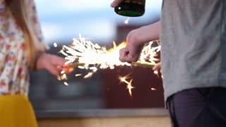 Friends having fun lighting up firework candles