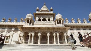Front of Jaswant Thada temple, with people taking pictures aside.