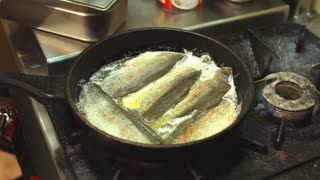 Frying fish in a pan