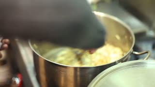 Frying onions in pot
