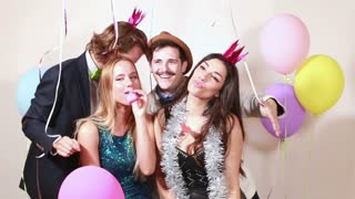 Funny crazy friends in photo booth