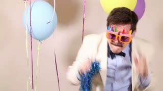 Funny man dancing with props in photo booth