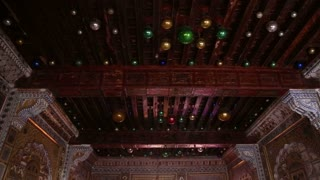 Gallantly decorated room inside of Mehrangarh fort, with colorful ceiling.