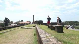 GALLE, SRI LANKA - MARCH 2014: Tracking shot of tourists walking along the walls of the Galle fort.