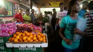 GALLE, SRI LANKA - MARCH 7, 2014: People in local grocery store. Local people in Sri Lanka are very friendly to tourists.