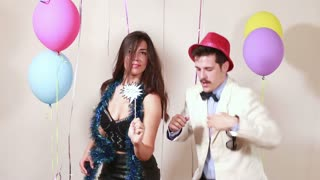 Girl and guy dancing like crazy in photo booth