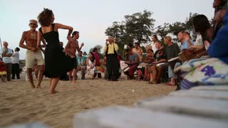 GOA, INDIA - 19 JANUARY 2015: Band playing on djembe on a sandy beach, with people dancing.