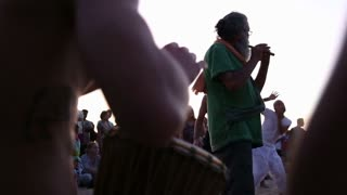 GOA, INDIA - 19 JANUARY 2015: Djembe band playing on a sandy beach, with people dancing.