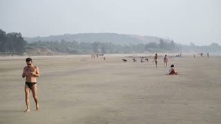 GOA, INDIA - 19 JANUARY 2015: People at sandy beach in Goa.