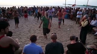 GOA, INDIA - 19 JANUARY 2015: People dancing on a sandy beach to the music played by djembe band.