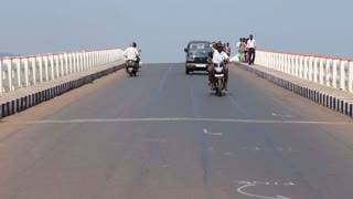 GOA, INDIA - 23 JANUARY 2015: Vehicles and people passing down the bridge in Goa.