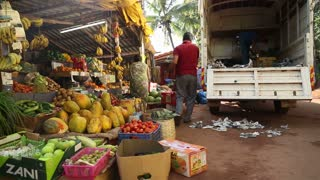 GOA, INDIA - 25 JANUARY 2015: Man loading products from a street stand to a truck.