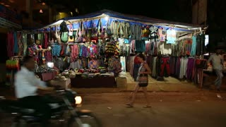GOA, INDIA - 26 JANUARY 2015: Colorful street stand in the night time in Goa, with vehicles passing.