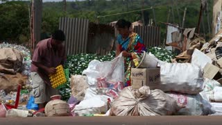 GOA, INDIA - 26 JANUARY 2015: Men sorting waste at a street disposal place in Goa.