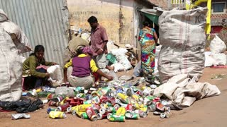 GOA, INDIA - 26 JANUARY 2015: Women and men sorting waste at a street disposal place in Goa.