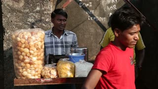 GOA, INDIA - 27 JANUARY 2015: Indian men around a street stand with local food in Goa.