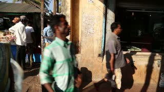 GOA, INDIA - 27 JANUARY 2015: People entering a building from a street in Goa.