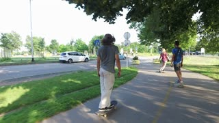 Group of friends riding on longboards and skateboard in city